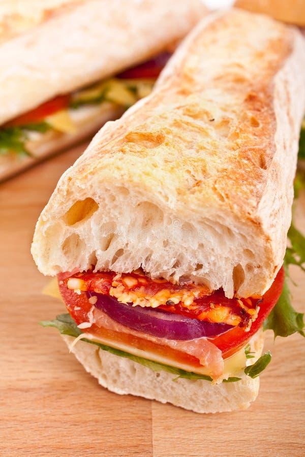 Sanduíche branco longo do baguette do trigo fotos de stock