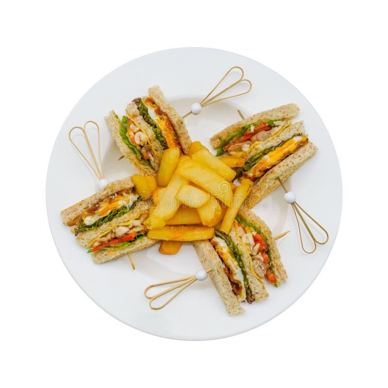 Sanduíche de clube na placa branca com o francês fritado isolado no trajeto de grampeamento incluído branco fotografia de stock