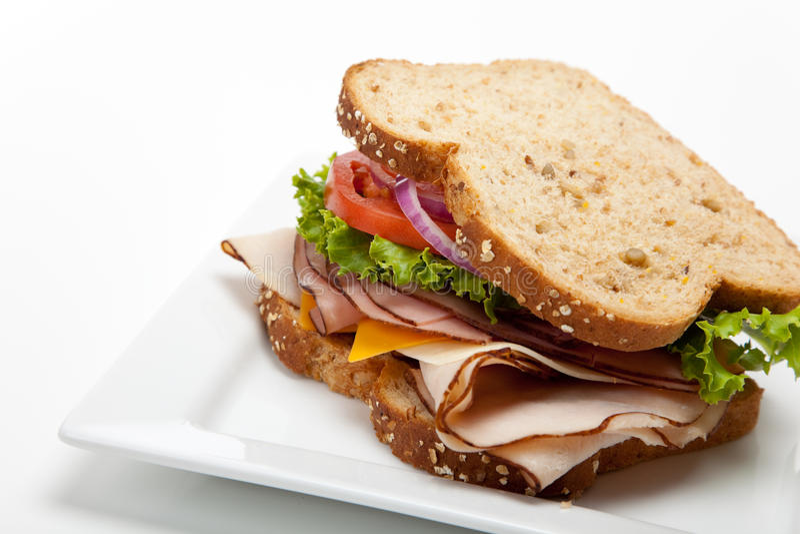Sanduíche de turquia no fundo branco fotos de stock royalty free