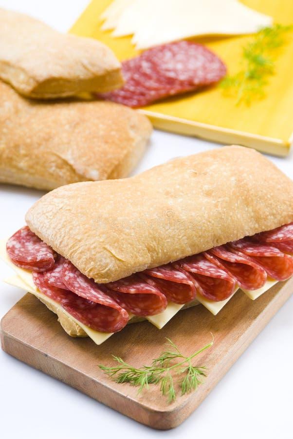 Sanduíche do Salami e do queijo imagem de stock