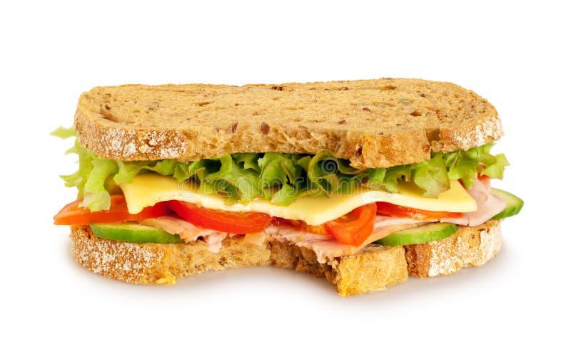 Sanduíche fresco mordido no fundo branco imagem de stock royalty free