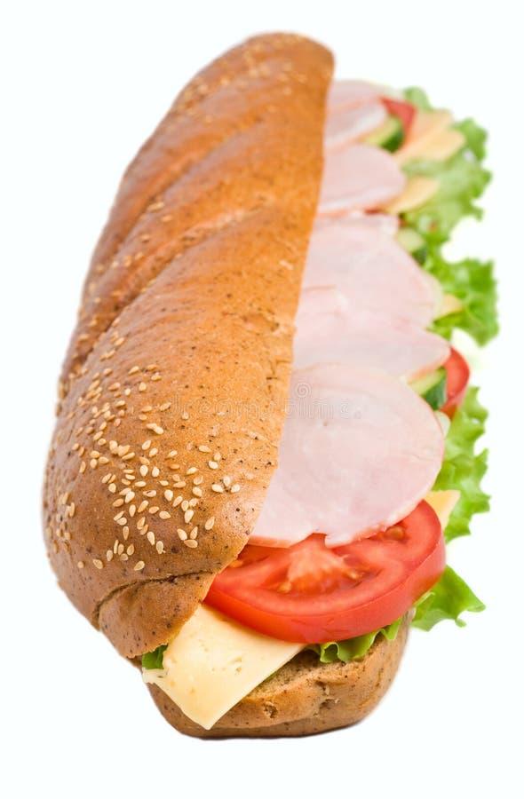 Sanduíche inteiro longo do baguette do trigo fotos de stock