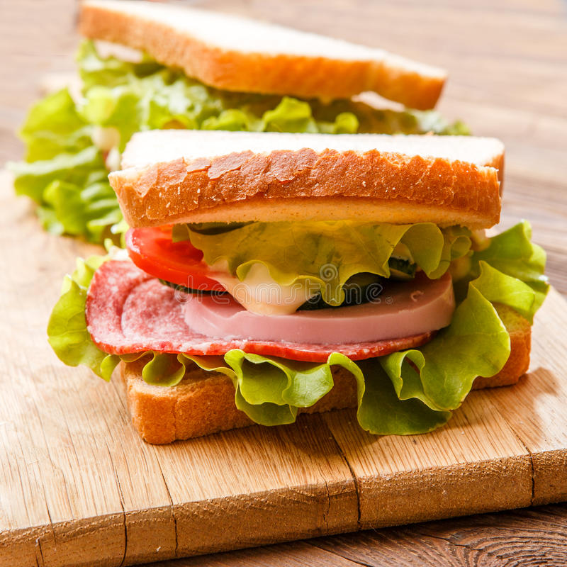 Sanduíches com salada e presunto fotografia de stock