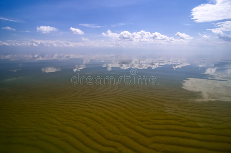 Sandwaves and crystal water of Curonian Bay stock images
