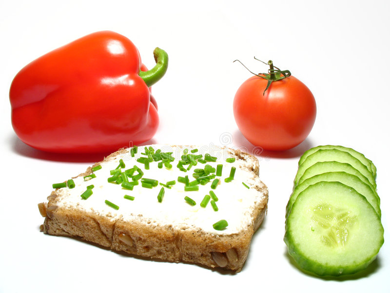 Sandwich. Detail bread with butter and fresh vegetable royalty free stock images
