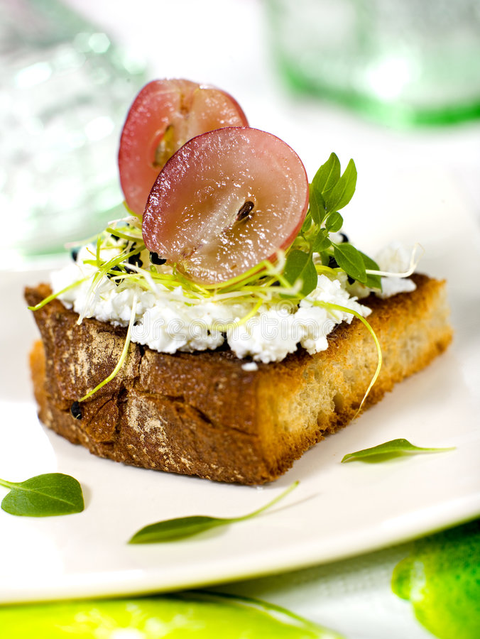 Sandwich. With cottage cheese with fresh grape and vegetable stock image