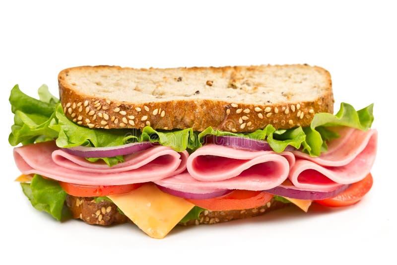 Sandwich avec du jambon, le fromage et la tomate photographie stock libre de droits