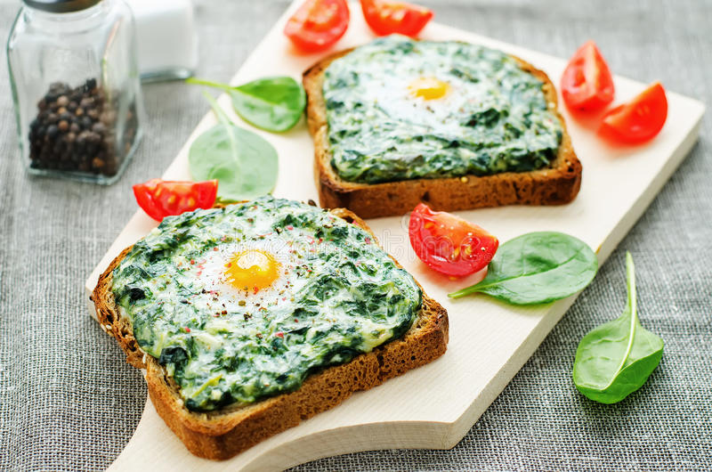 Sandwich baked with spinach, cream cheese and egg royalty free stock photography