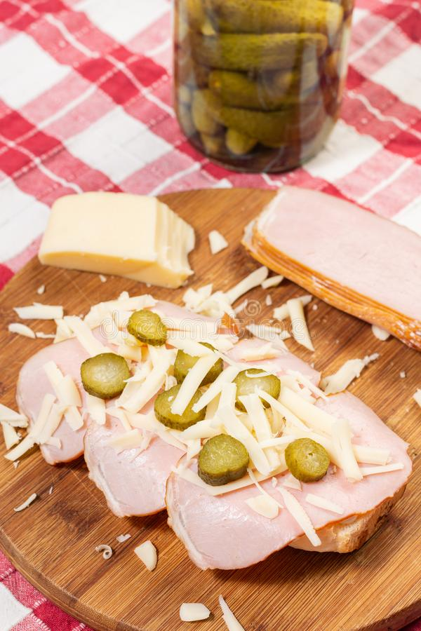 Sandwich with bread ham cheese and pickles. Lunch, food, vegetable, meal, meat, snack, dinner, tomato, bacon, healthy, fresh, sauce, lettuce, breakfast stock images