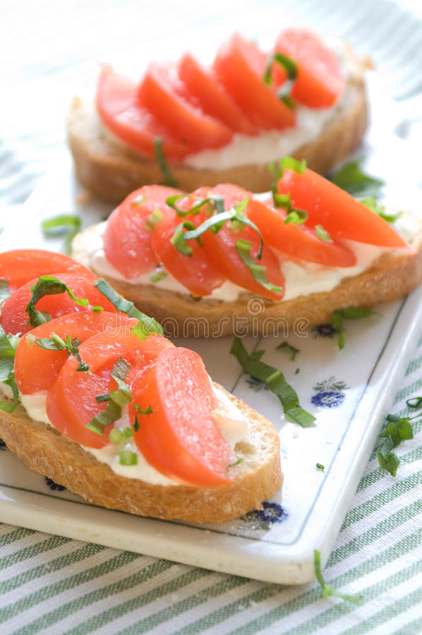 Sandwich for breakfast. Sandwich with raw tomatoes for breakfast, great for those spring days royalty free stock images