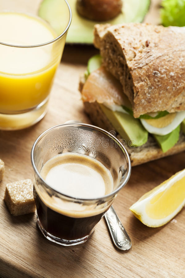 Sandwich for breakfast. Rye bread sandwich with avocado, eggs, cucumber and smoked salmon stock photography