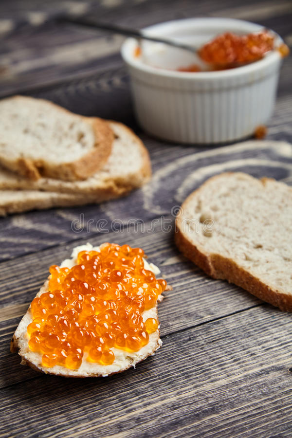 Sandwich with butter and red salmon caviar stock image