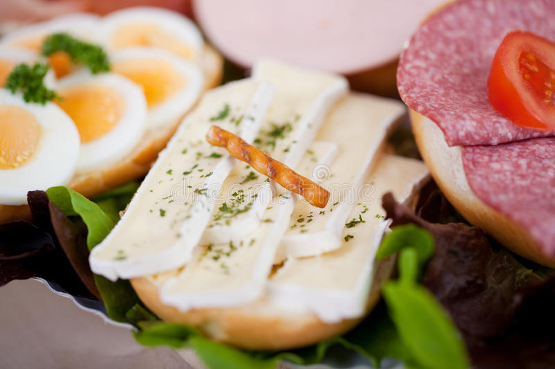 Sandwich with camenbert cheese. On a plate royalty free stock image