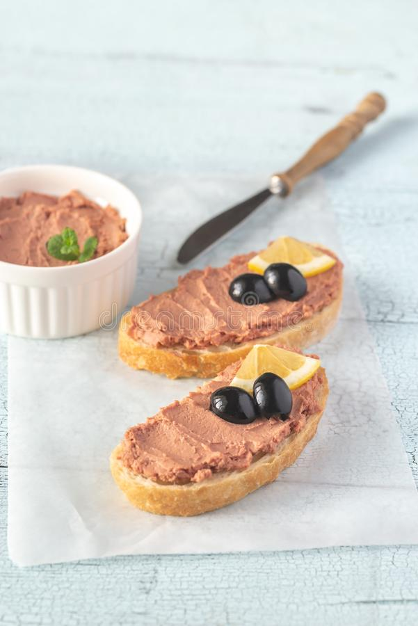 Sandwich with chicken liver pate and black olives stock image