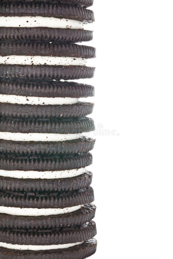 Sandwich Chocolate Cookies. Close-up of half tower of sandwich chocolate cookies with cream. On white stock photo