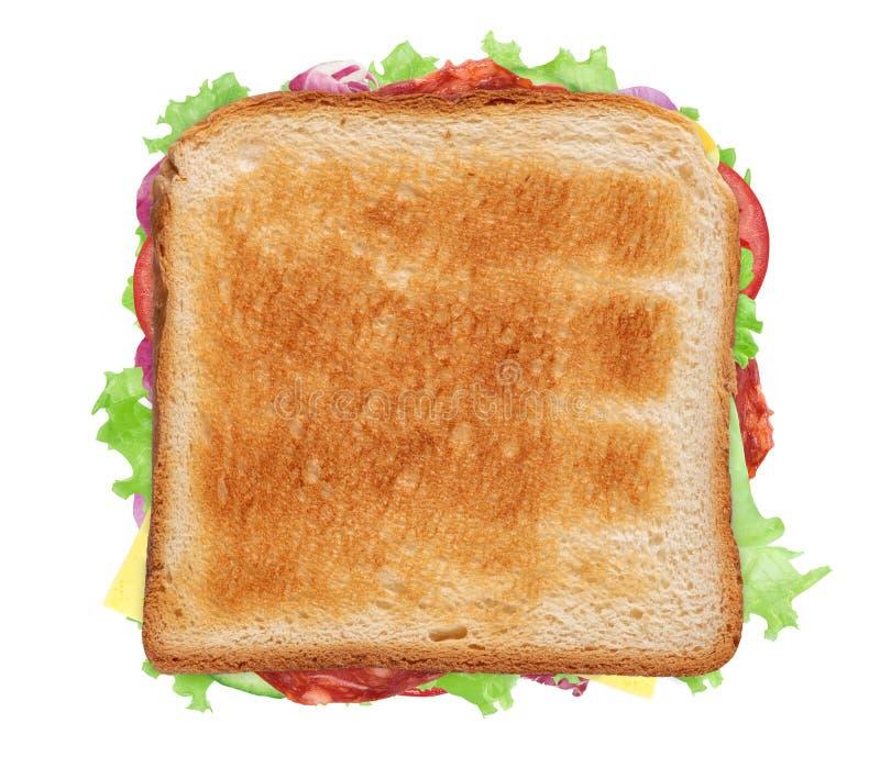 Sandwich con jamón, queso, tomates, lechuga y pan tostado foto de archivo