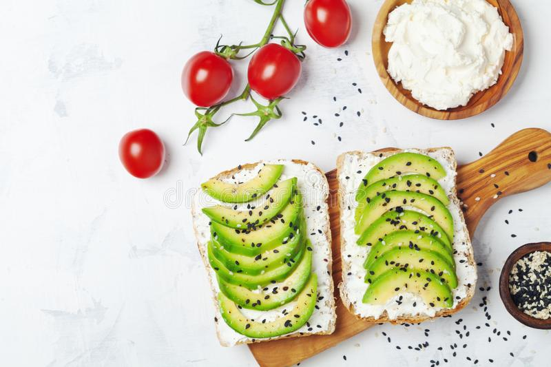 Sandwich with creamy cheese and avocado for healthy snack or breakfast. Top view royalty free stock images