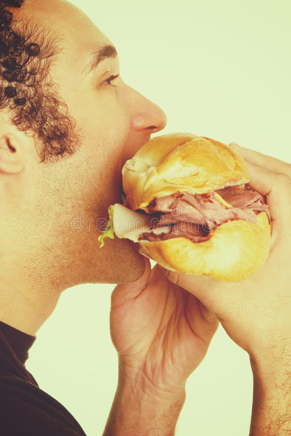 Sandwich Eating Man royalty free stock photography