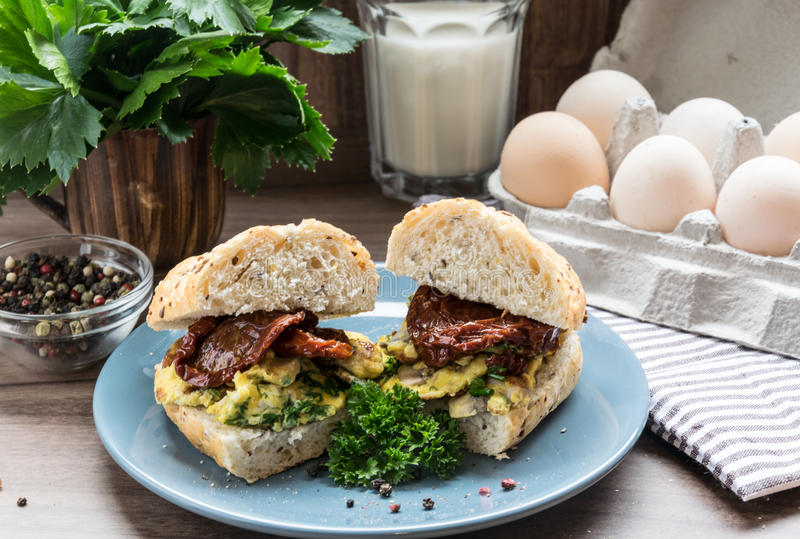 Sandwich with egg and dried tomatoes stock photography
