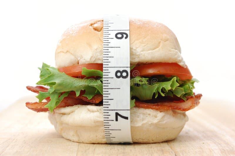 Sandwich et bande de mesure photos stock