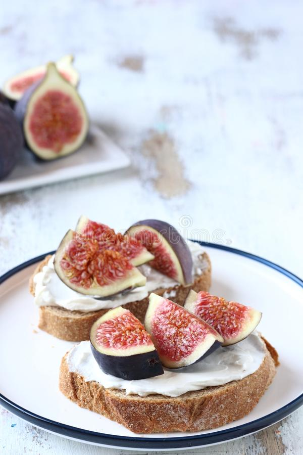 Sandwich with fig and cheese,honey stock image