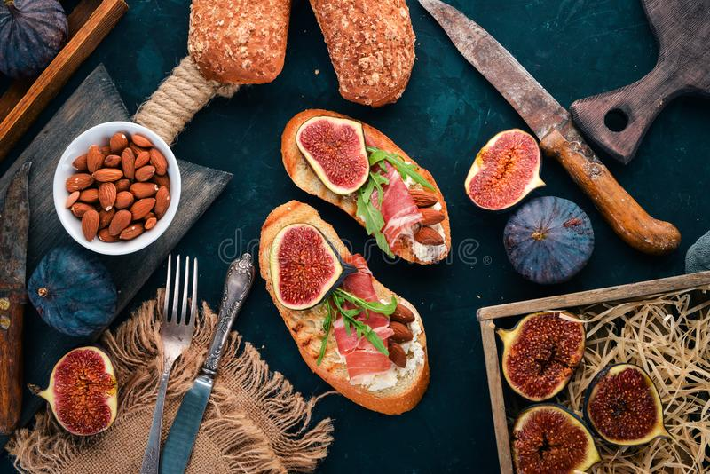 Sandwich with figs, prosciutto and cheese. royalty free stock photos