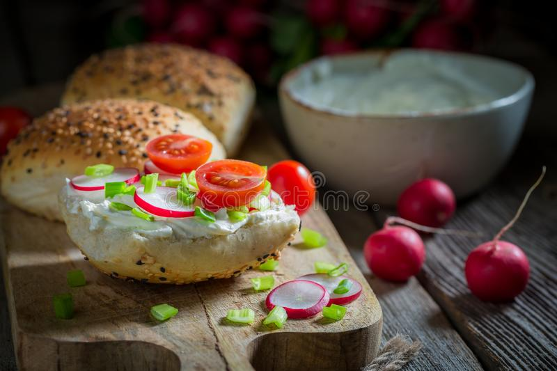 Sandwich with fromage cheese and cherry tomatoes. On wooden table royalty free stock photos