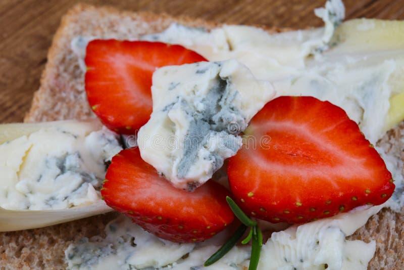 Sandwich with gorgonzola and strawberry stock image