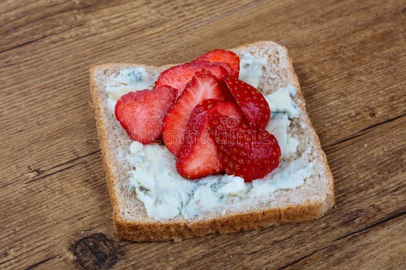 Sandwich with gorgonzola and strawberry royalty free stock image