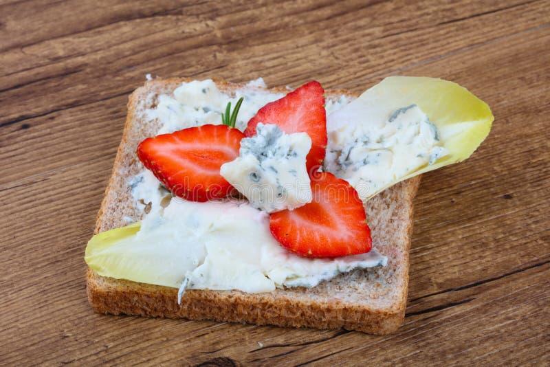 Sandwich with gorgonzola and strawberry stock photos
