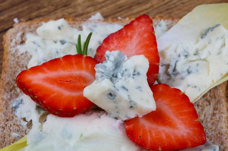 Sandwich with gorgonzola and strawberry stock photography