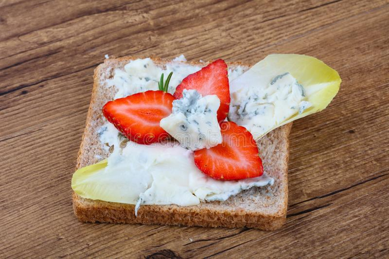 Sandwich with gorgonzola and strawberry stock images