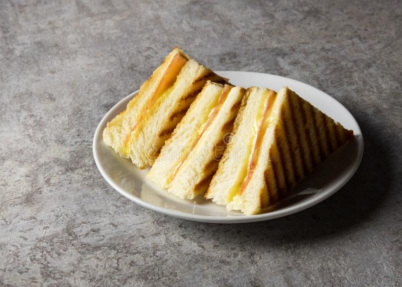 Sandwich, Grilled ham with cheese sandwich on a plate stock photos