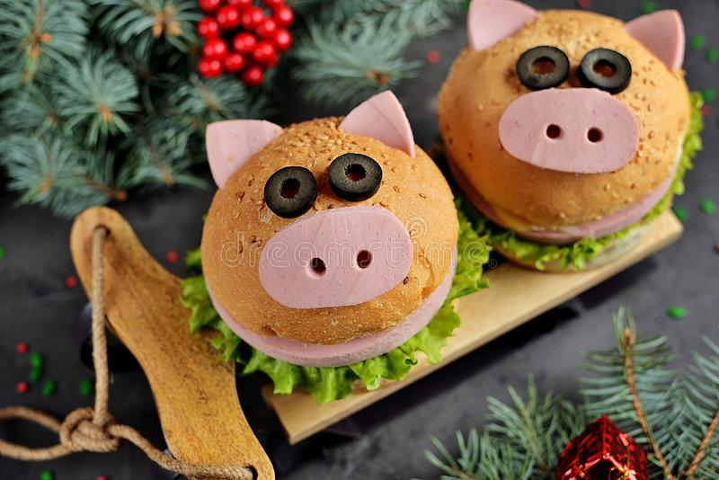 Sandwich with ham, cheese and lettuce in the form of cute pig - symbol of 2019. Children`s breakfast. Christmas background. Top vi royalty free stock photo