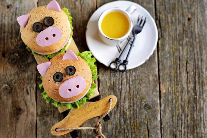 Sandwich with ham, cheese and lettuce in the form of cute pig - symbol of 2019. Children`s breakfast. Christmas background. Top vi stock photo