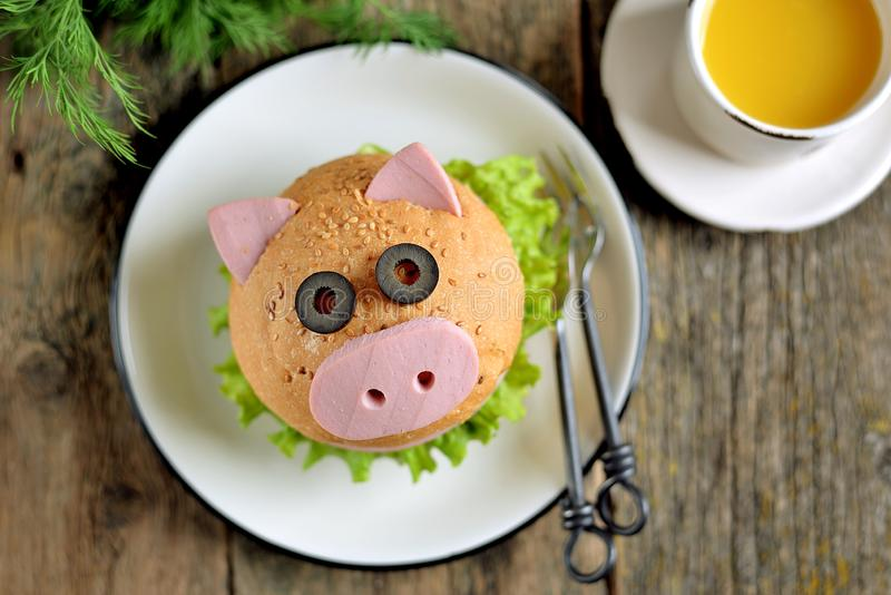 Sandwich with ham, cheese and lettuce in the form of cute pig - symbol of 2019. Children`s breakfast. Christmas background. Top vi royalty free stock photos