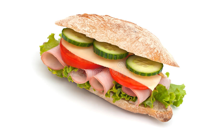 Sandwich. With ham, cheese, tomatoes and cucumber stock image