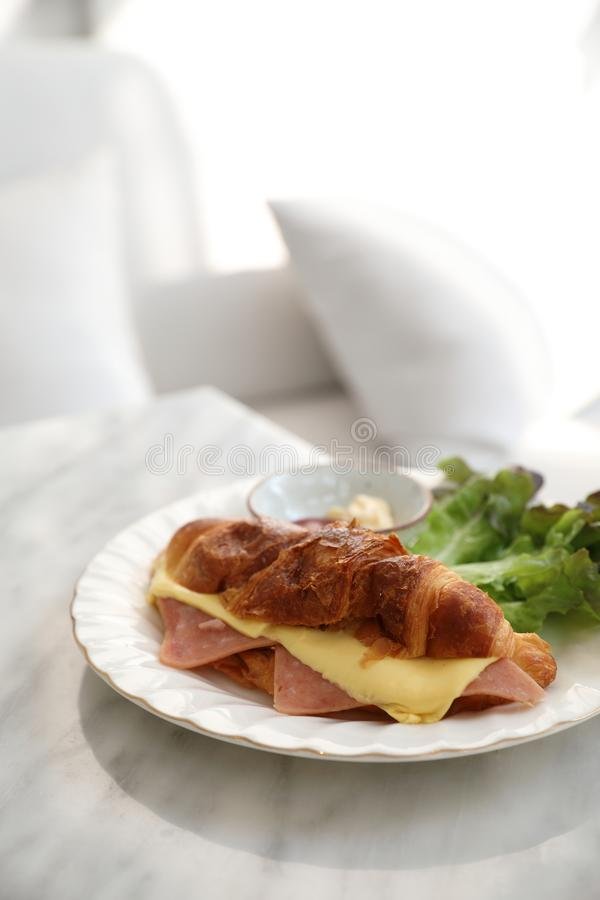 Sandwich ham and cheese on white table in coffee shop stock photos