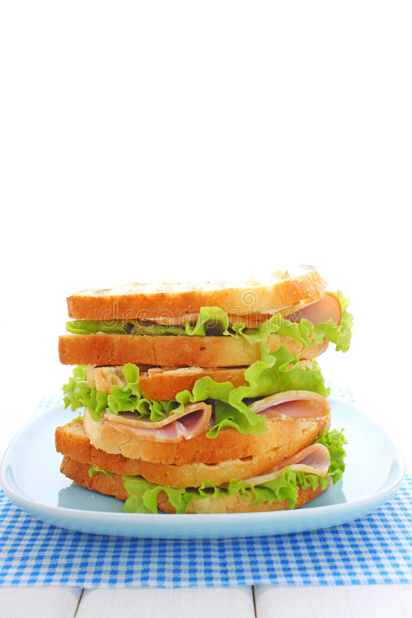Sandwich with ham, cream cheese. And lettuce stock image