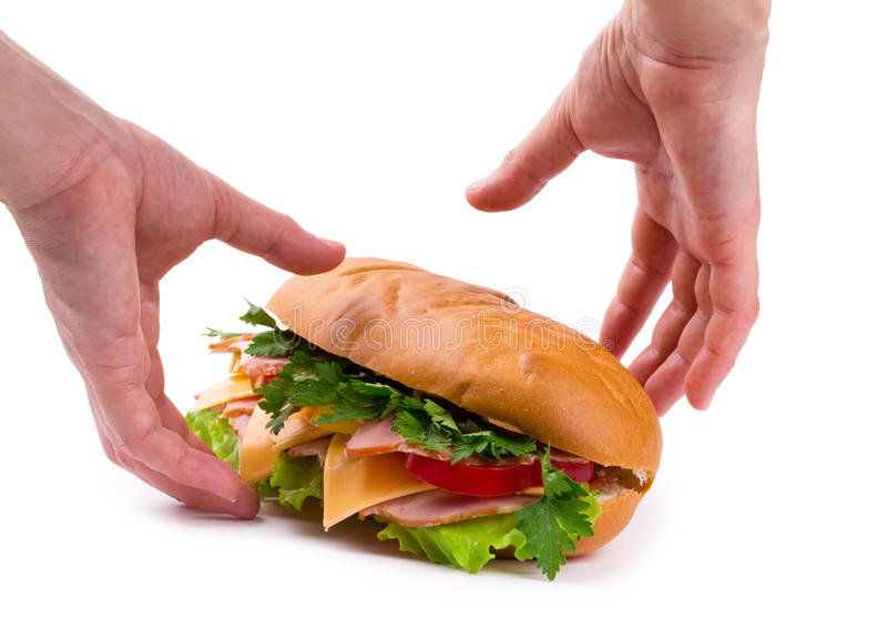 Sandwich with a ham, paprika and cheese in hands royalty free stock photography