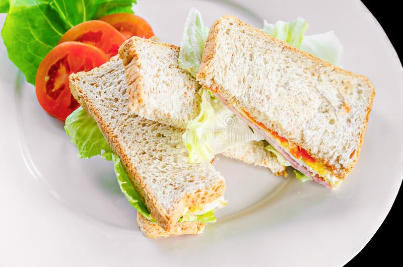 Sandwich with ham tomato and egg with vegetable royalty free stock image