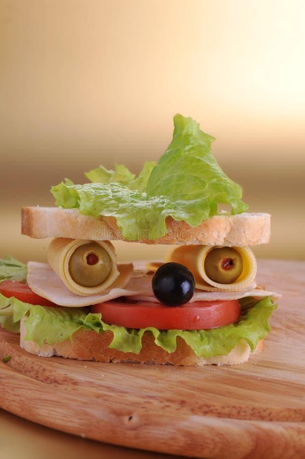 Sandwich looks like face. Fresh sandwich looks like face stock photography