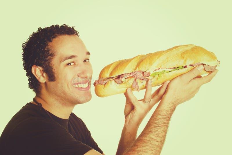 Sandwich mangeant l'homme photos libres de droits