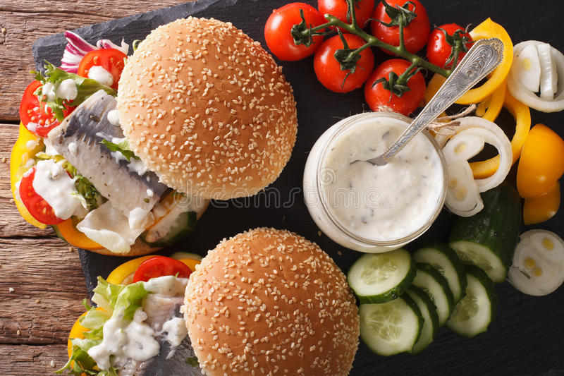 Sandwich with marinated herring, gravy and fresh vegetables clos stock photos