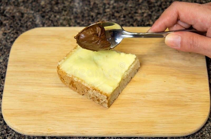 Sandwich met boter en chocolade stock foto's