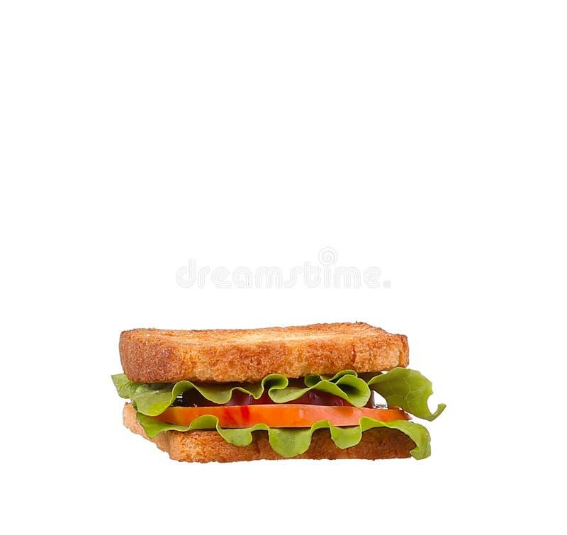 Sandwich mit Tomaten, Schinken und Käse isoliert stockfotos