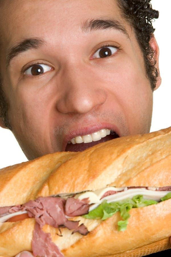 Sandwich mordant à homme photos libres de droits