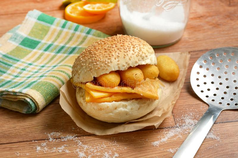 Sandwich with panelle - traditional street food of Sicily - made. With chickpea flour - closeup stock photos