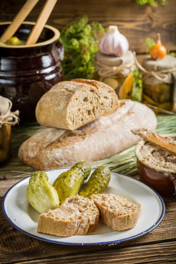Sandwich in the pantry from the winter stocks. On old wooden table royalty free stock images