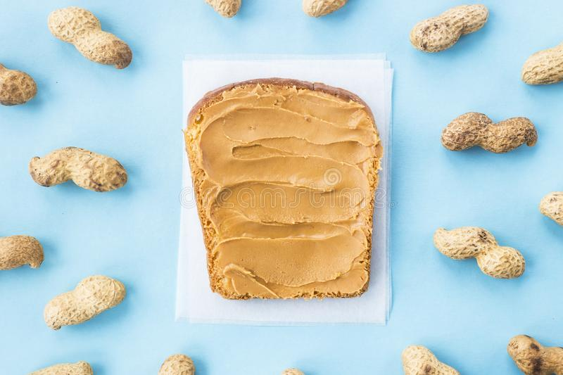 Sandwich with peanut butter on a blue background stock image